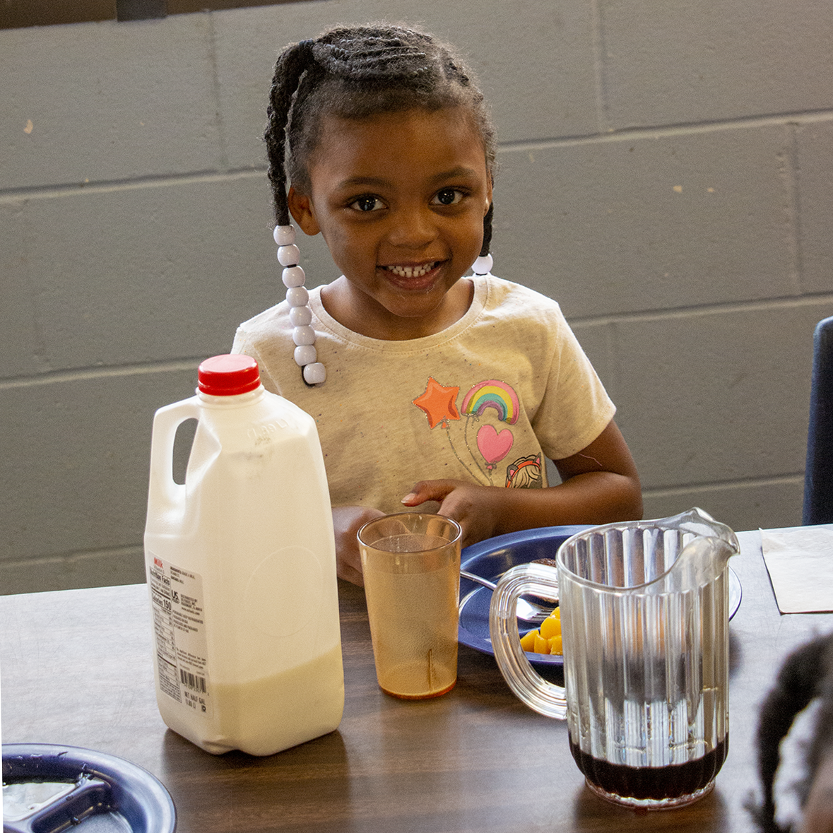 A child eats lunch at the Child Development Center
