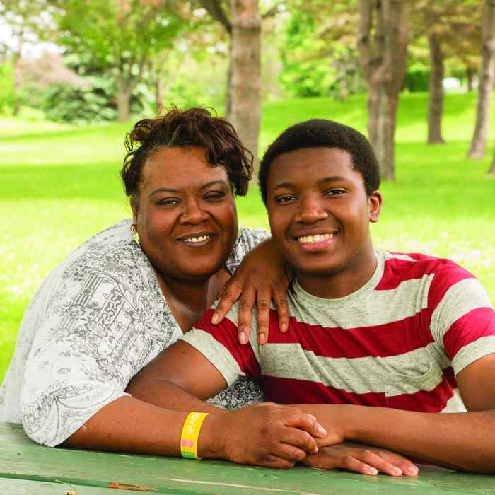 African American mother and son sitting at picnic table, kofi services for african american youth,