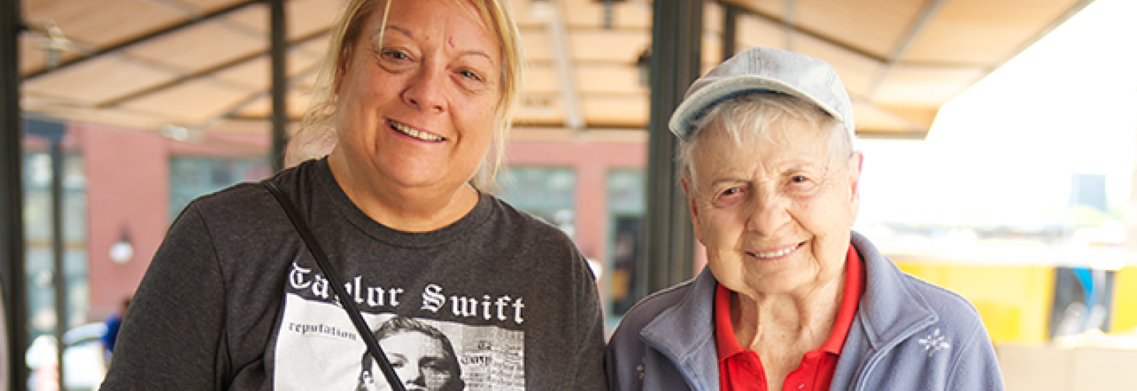 Older adult and their family caregiver at a market in Saint Paul, MN