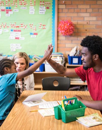 Student and teacher in Saint Paul Promise Neighborhood