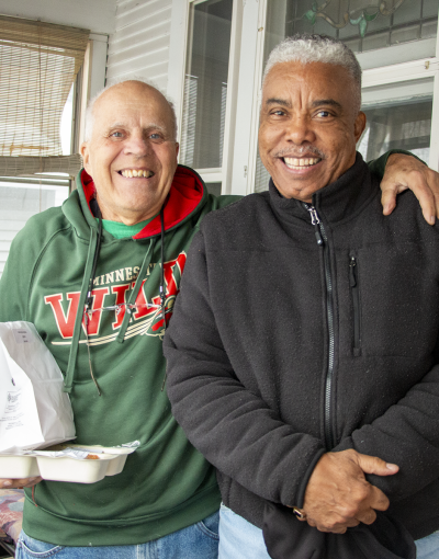 Meals on Wheels recipient Ron Walcheski with volunteer Steven Jones