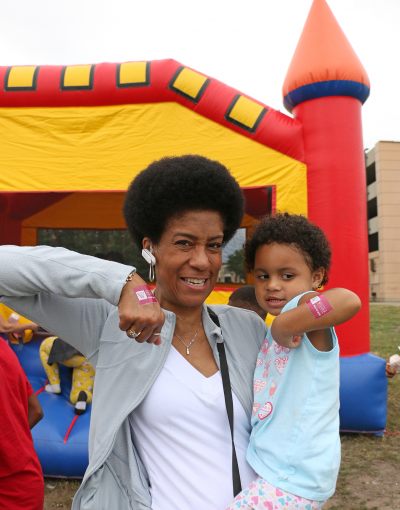 Family attends Wilder Foundation's summer block party community celebration in August 2019