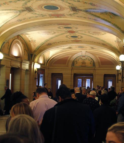 Line of people waiting inside Capitol