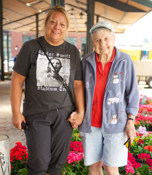 Caregiver with woman at farmers market