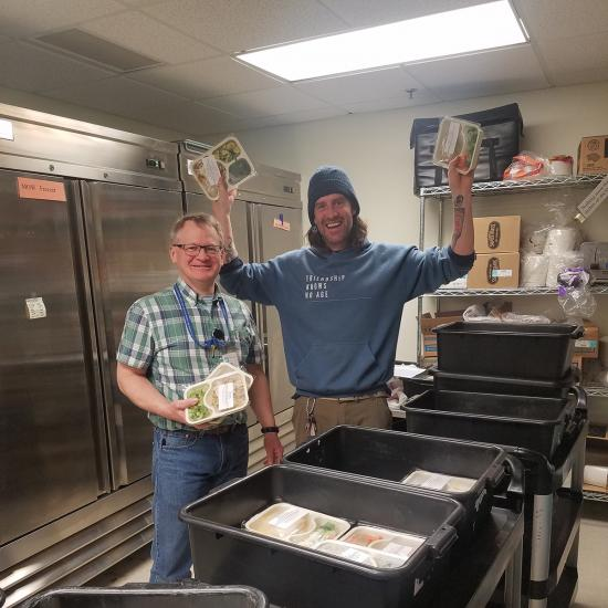 Wilder employee and volunteer pack frozen meals for Meals on Wheels customers