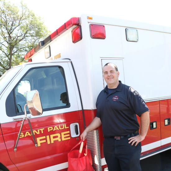 Jeremy Berger, Saint Paul Fire Department, delivers Meals on Wheels at Wilder