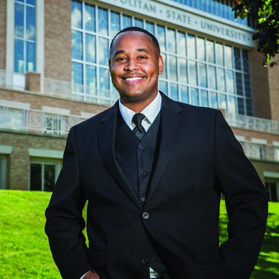 African American man smiling in suit, African and Native American adult, person of color, Kofi alum, Wilder school-based mental health program graduate