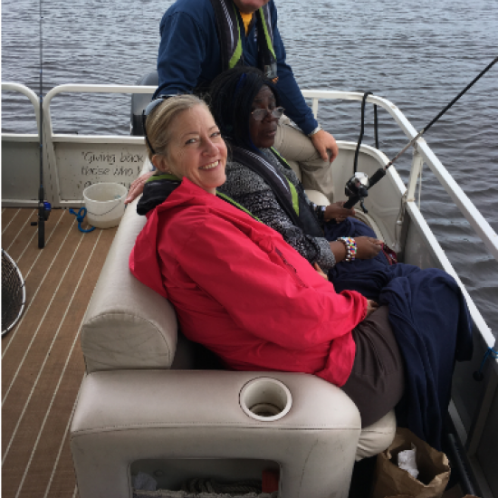 Mary Cahill and Wilder Adult Day Health participant on a boat