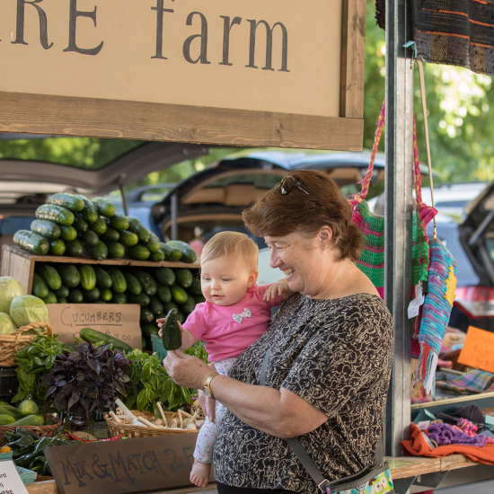 Woman and child shopping for healthy food at farmer's market