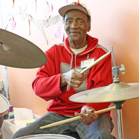 Adult Day Health participant Greg Mitchell pursues his passion for drumming at the Wilder Community Center for Aging