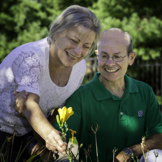 wilder foundation caregiving services, caregiver support group for dementia and memory loss, older adult couple picking flower, adult day care program