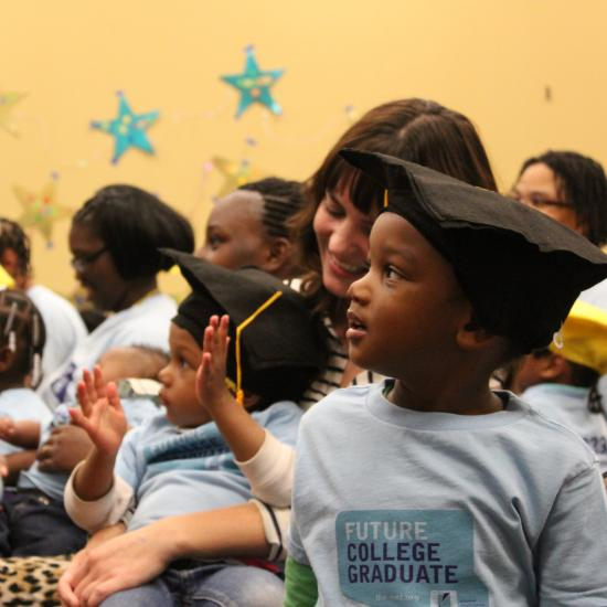 Parents and young children at graduation event