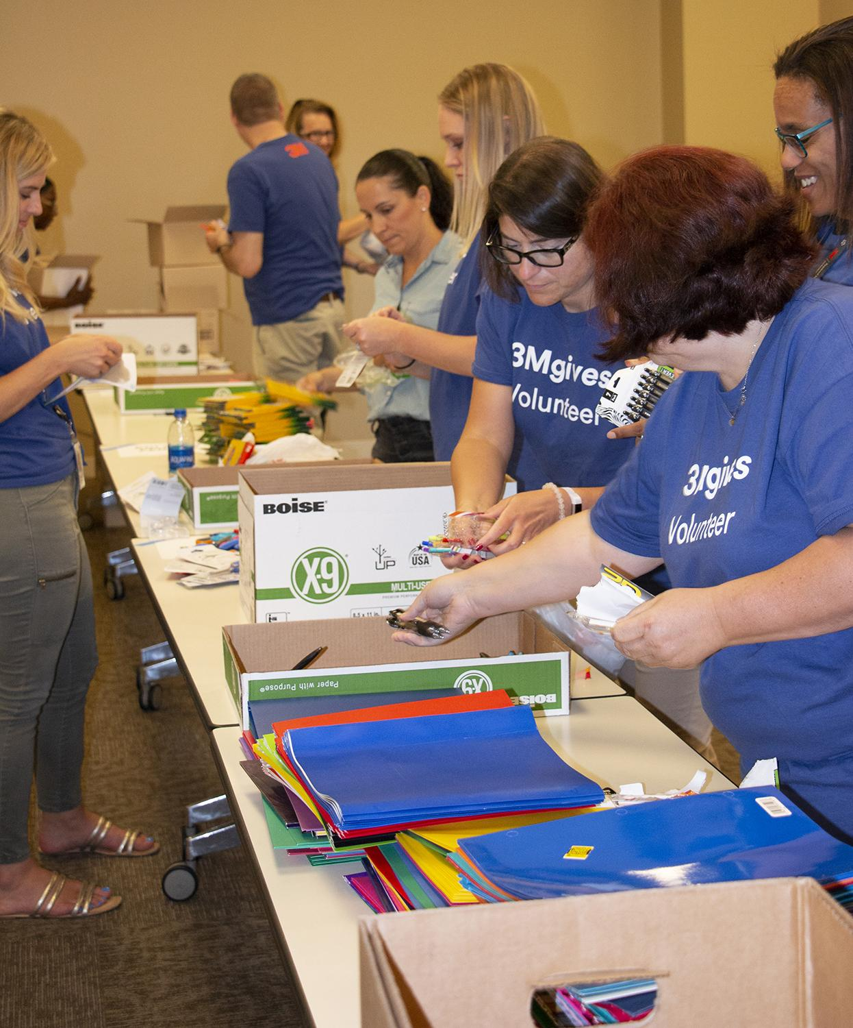 3M volunteers at Wilder with the annual backpack drive