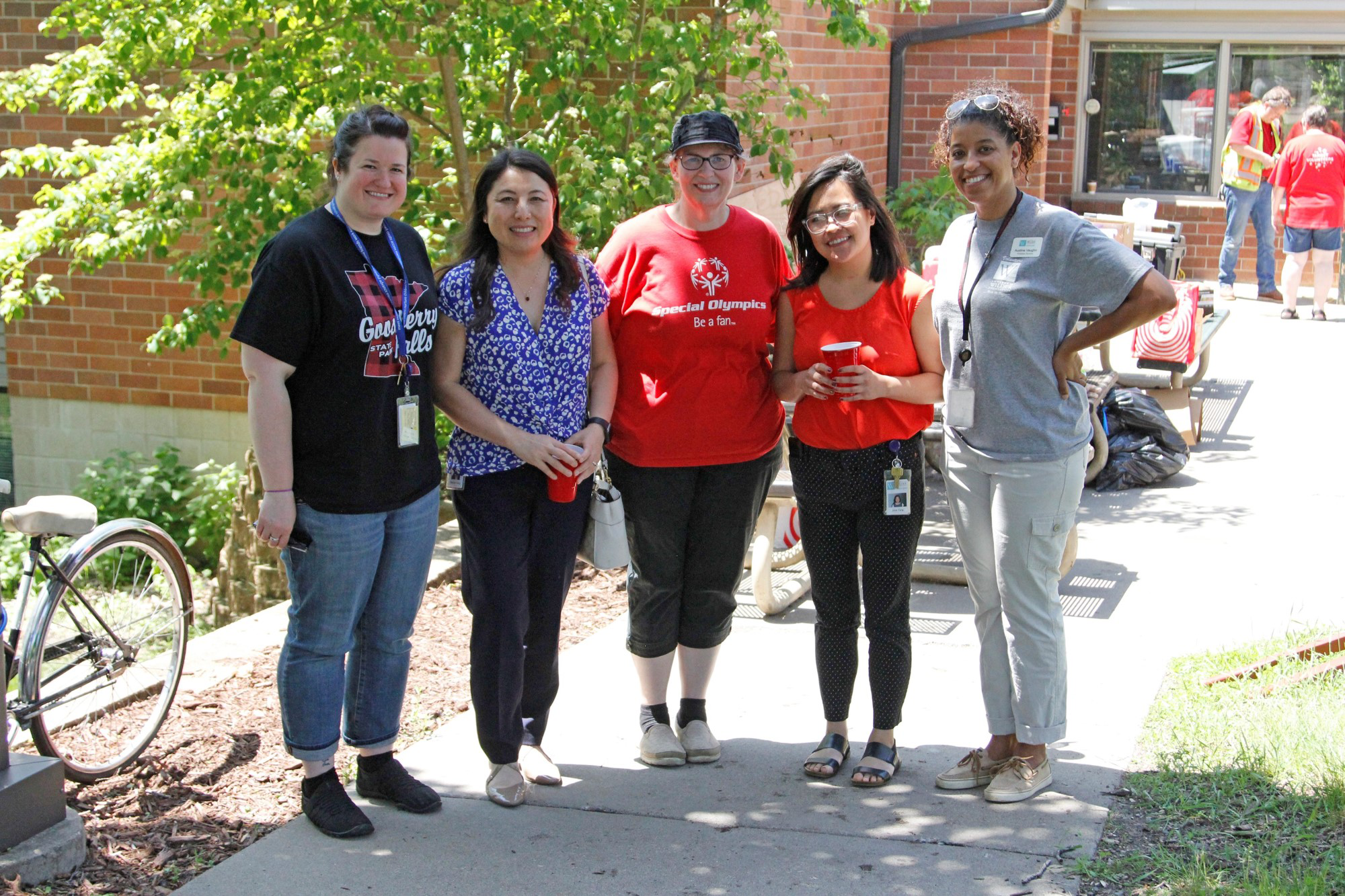 Five Wilder and Target staff pose outside the Wilder Center for Social Healing.