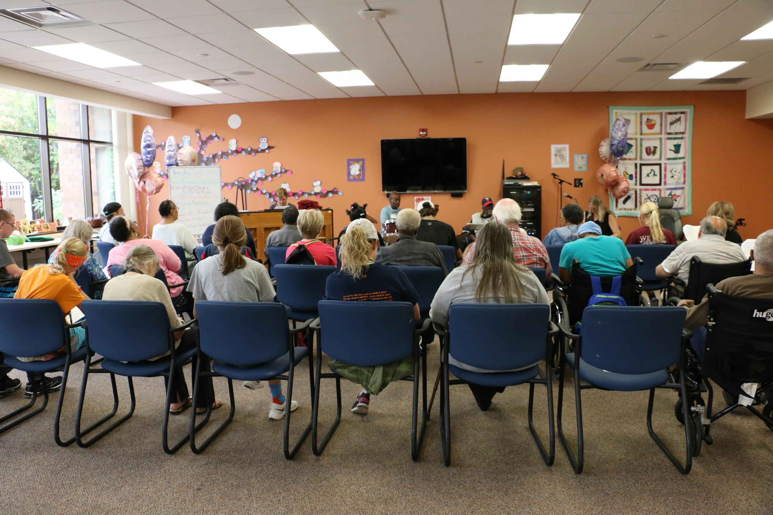 Adult Day Health Program participants enjoy music and singing as part of their daily routine of creative activities