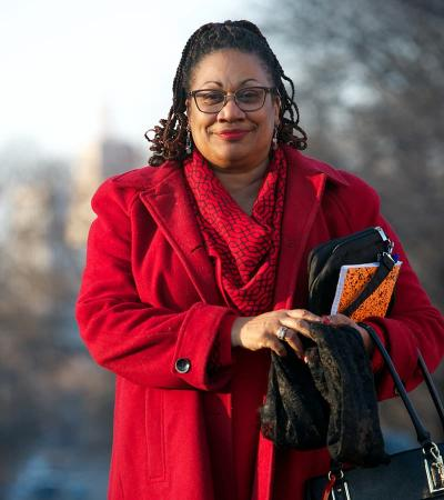 Woman standing outside wearing red jacket