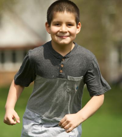 A boy runs toward the camera.