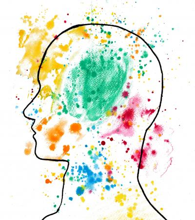 outline of person's head with paint splatters