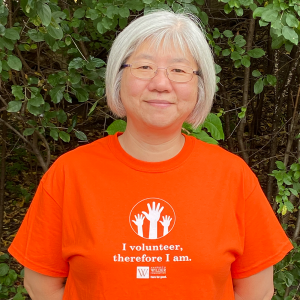 Asian female volunteer in orange t-shirt